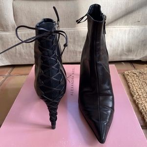 High-heel black boots with lace up back